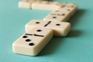 Playing dominoes on a light background . The concept of the game of dominoes. Close up.