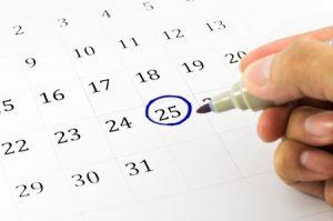 blue circle. mark on the calendar at 25.