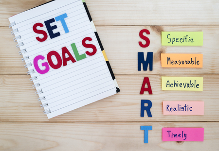 senior goal setting - smart goals in wood background