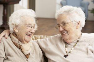 working in retirement - senior friend helping another senior